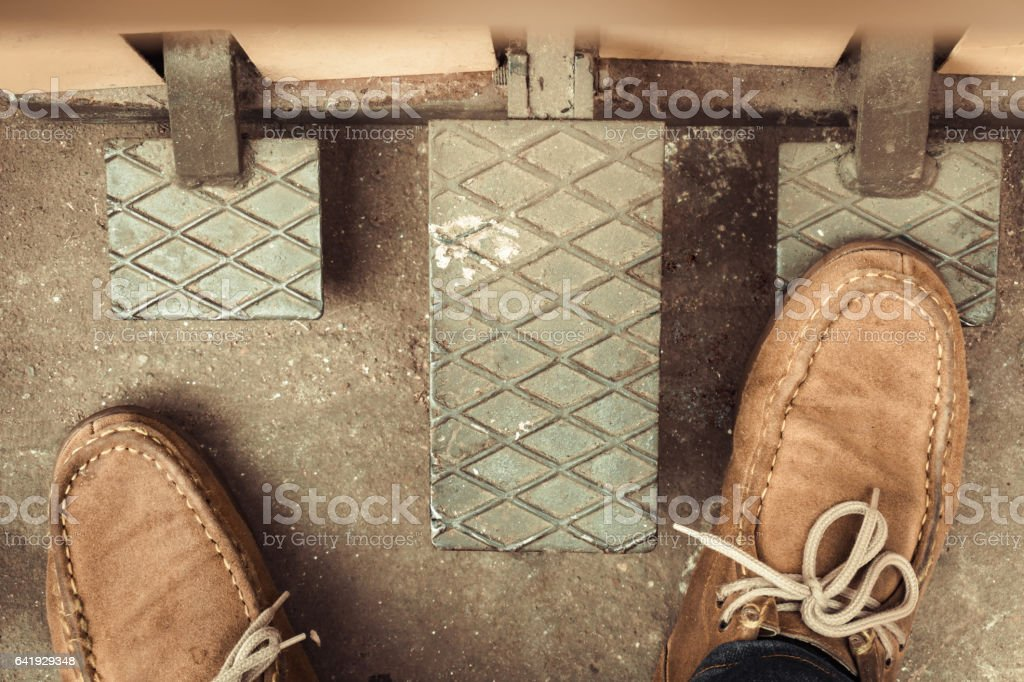 Testing Stepping on car gas pedal stock photo