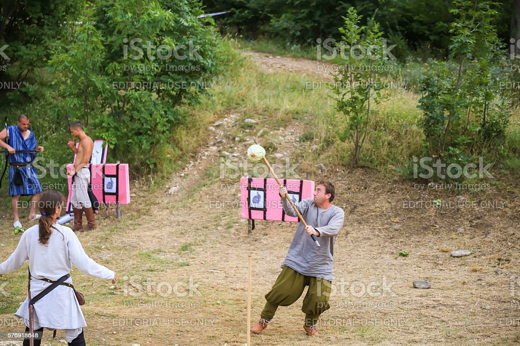 Testing the sharpness of medieval weapons stock photo