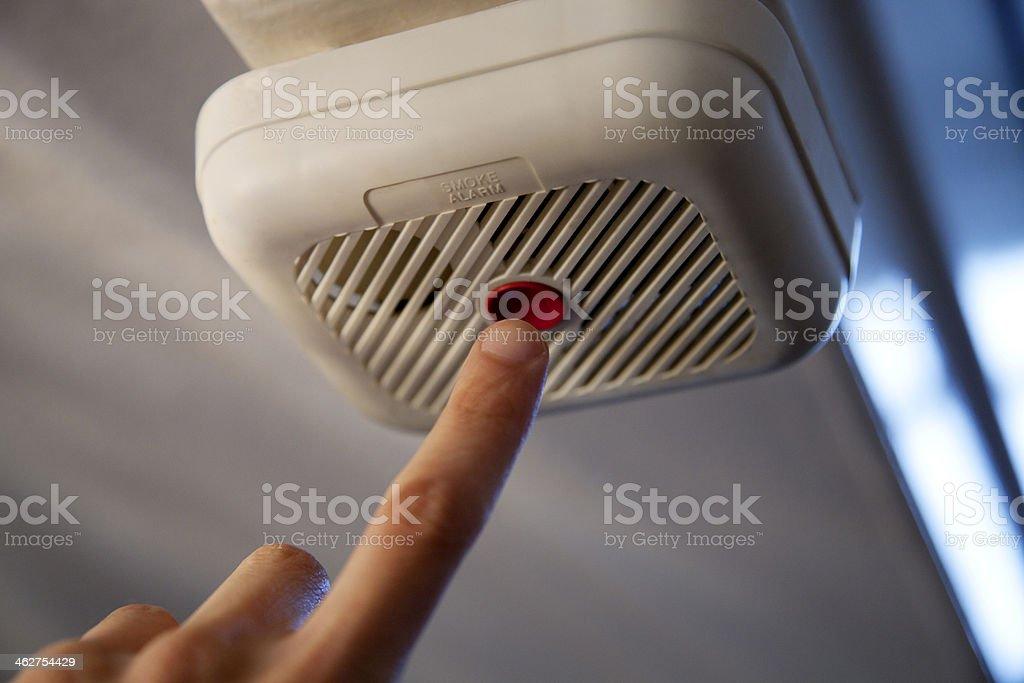 Testing the smoke alarm stock photo