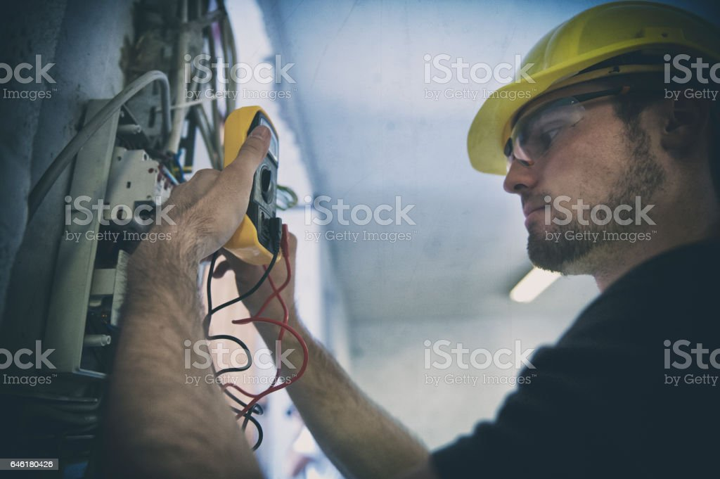Testing  voltage in a fuse box stock photo