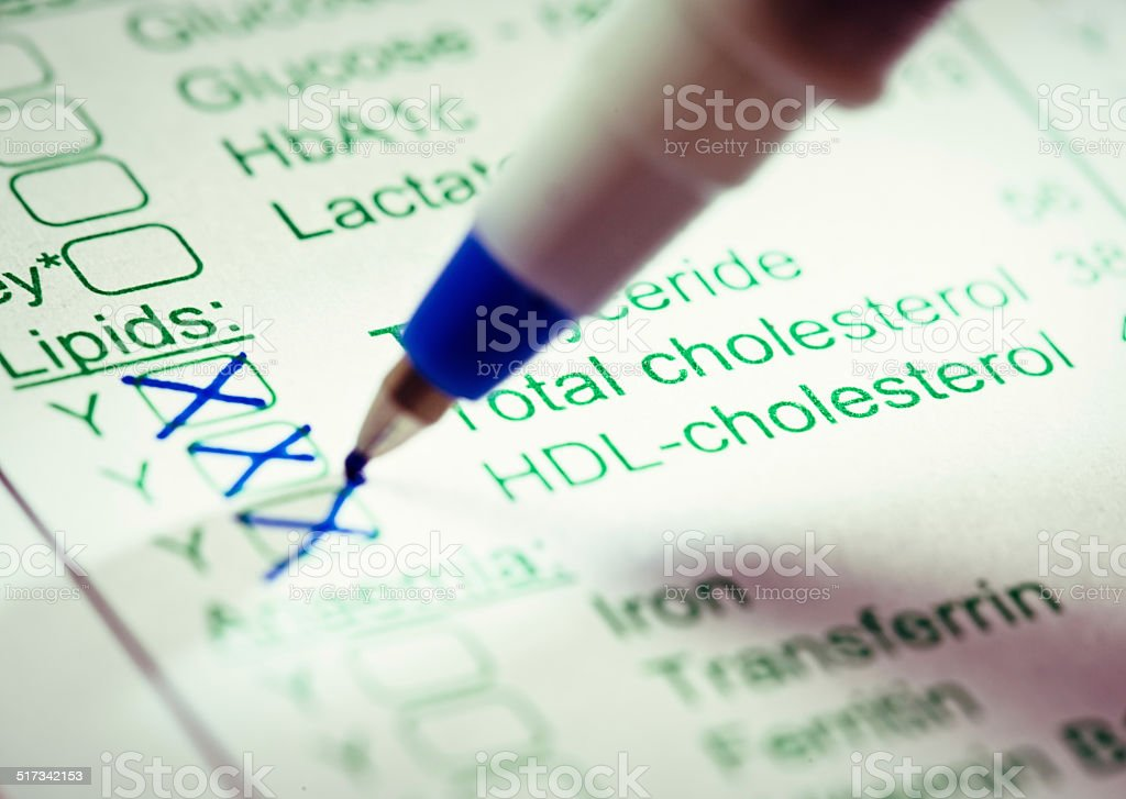 Tests for cholesterol and triglycerides marked on medical form stock photo