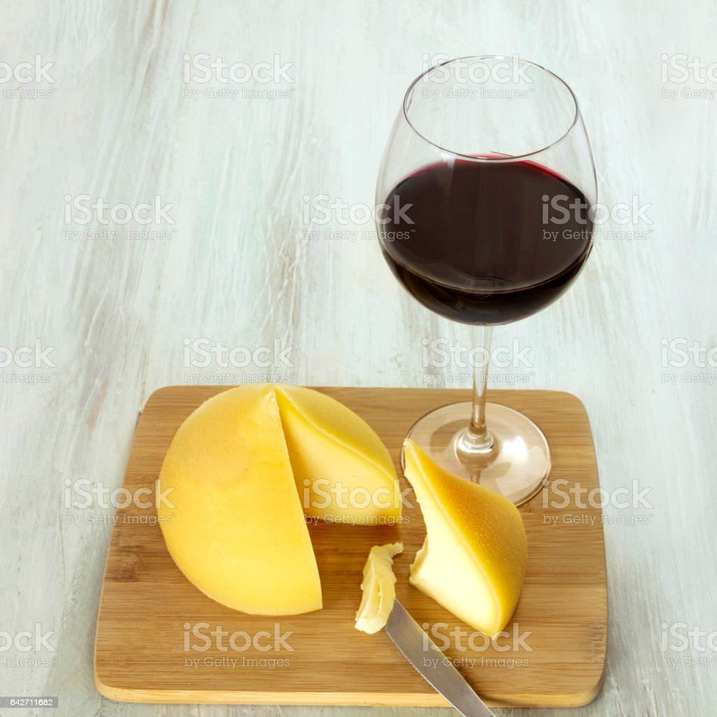 Tetilla, traditional Spanish cheese, with a glass of wine stock photo