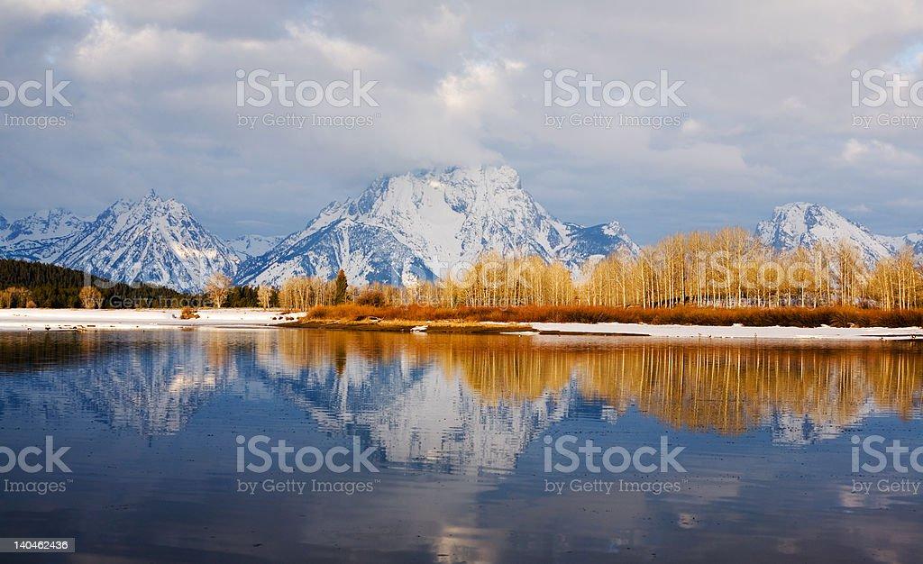 Teton Mountain Range from Oxbow Bend at Sunrise stock photo