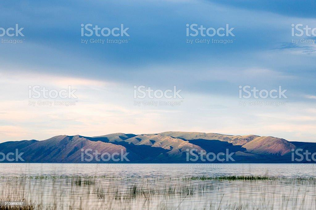 Teton Range, lake and dusk stock photo