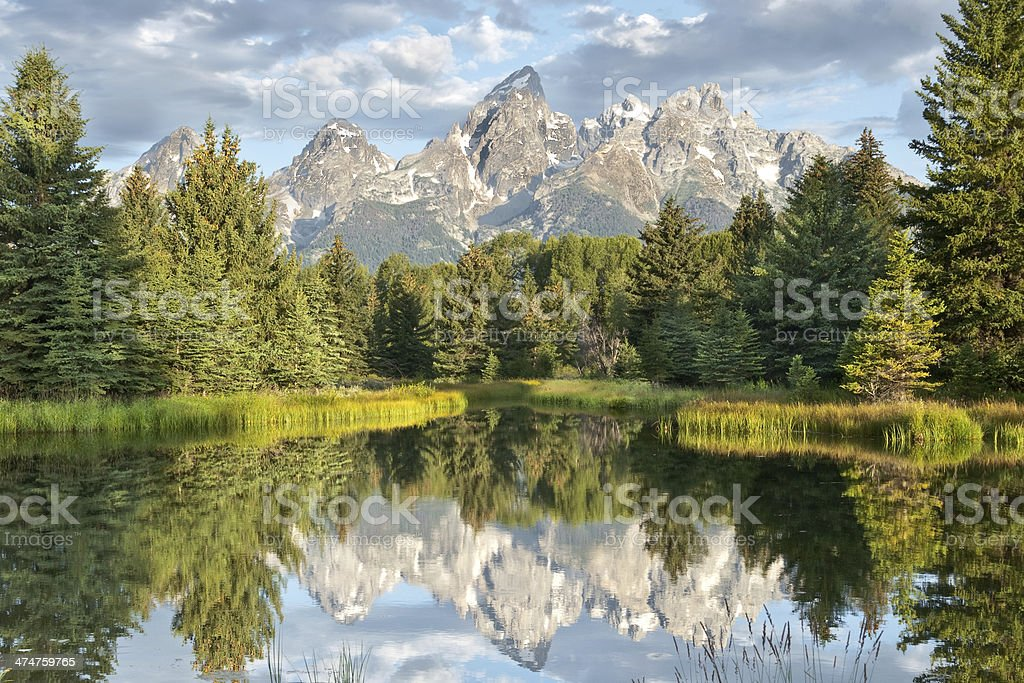 Teton Range Reflected in the Snake River stock photo