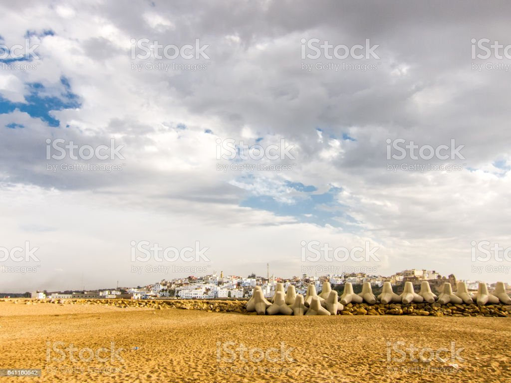 Tetrapods and town behind stock photo