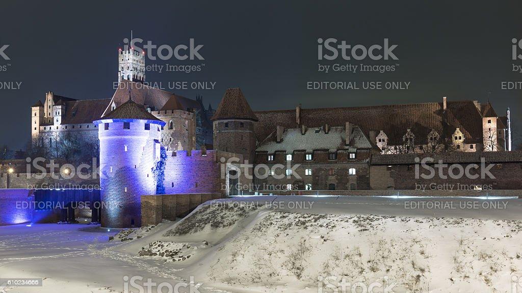 Teutonic Knights in Malbork castle at night. stock photo