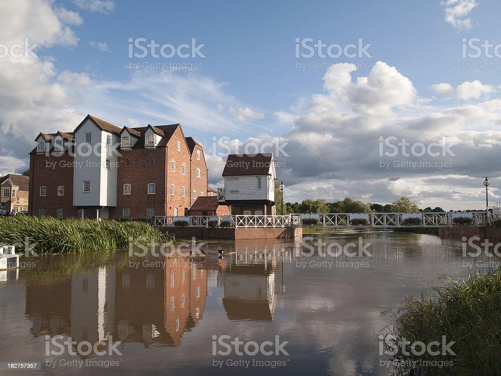 Tewkesbury Old Mill and footbridge wide shot stock photo