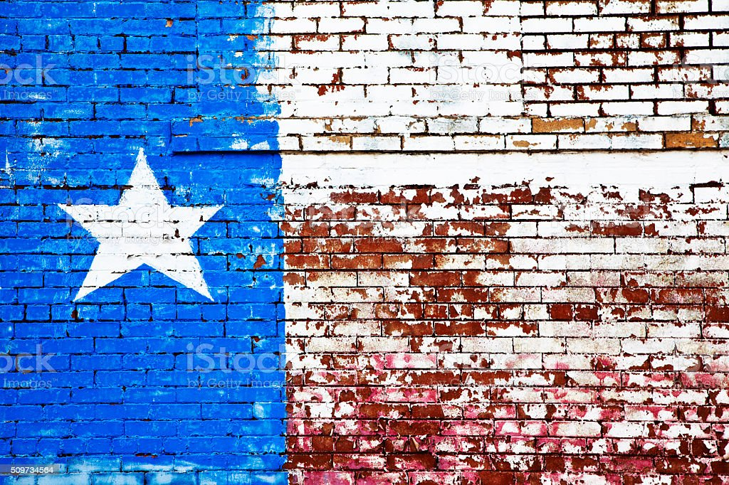 Texas flag painted on brick wall.  Old peeling paint, rustic. stock photo