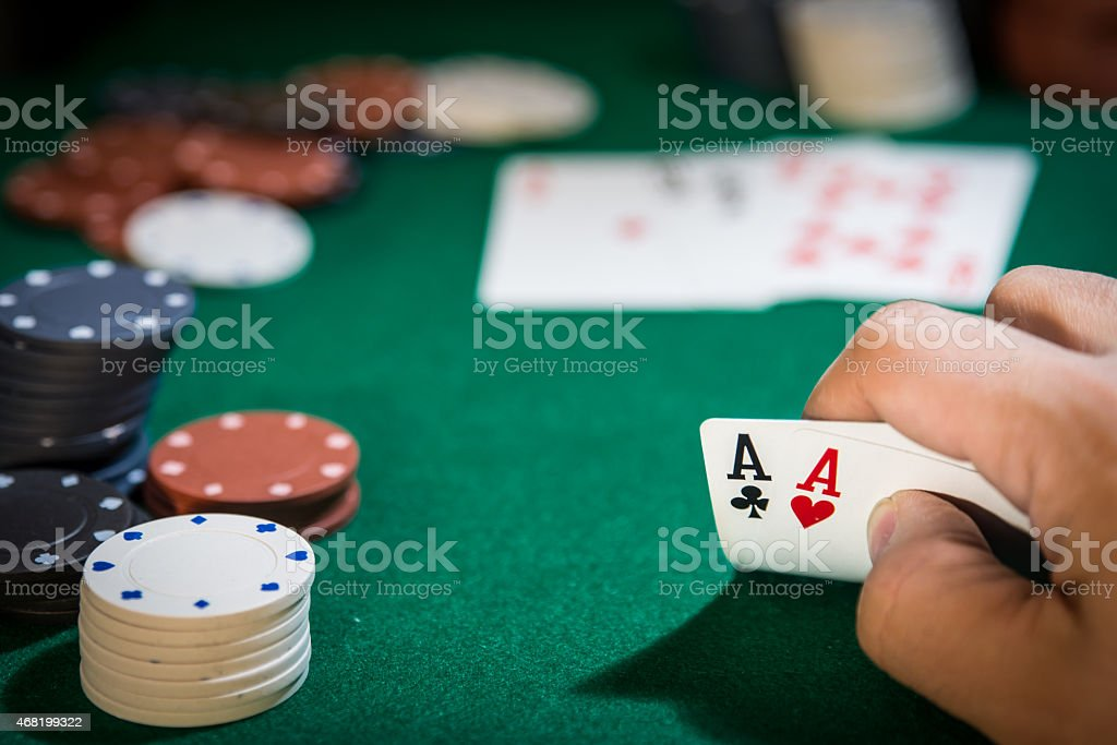 Texas Holdem hand with two aces stock photo