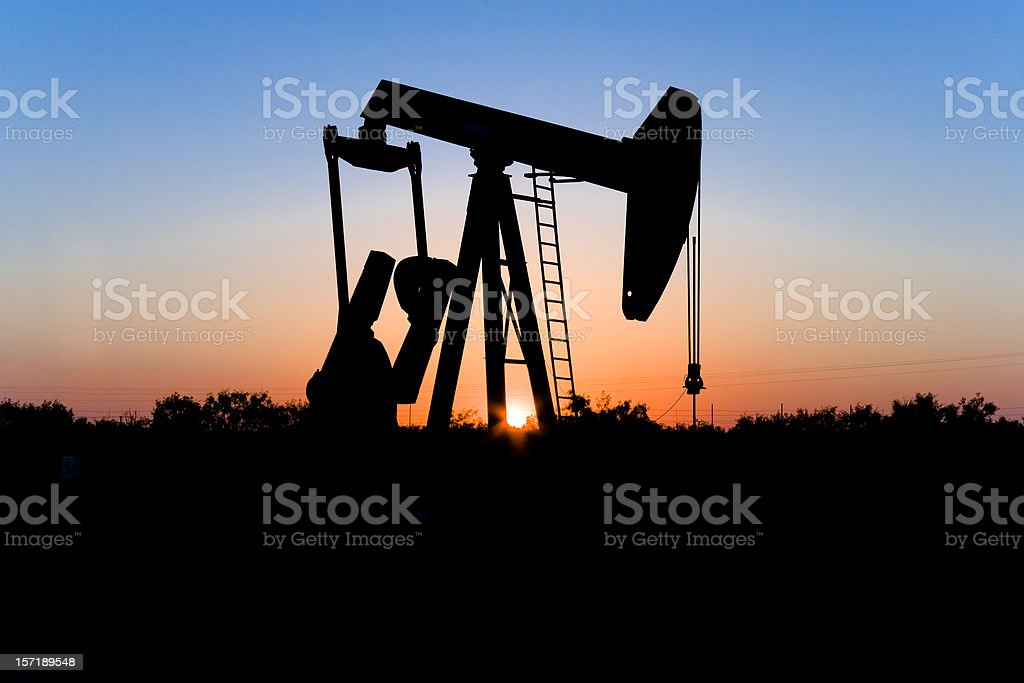 Texas oil well pump pumpjack sunset royalty-free stock photo