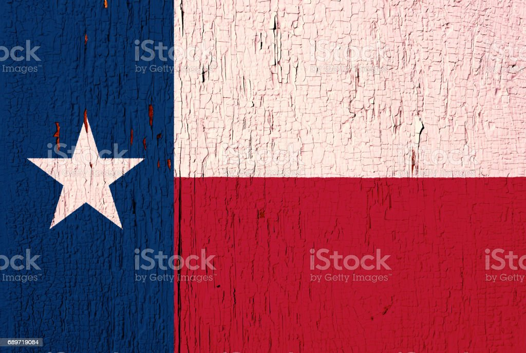 Texas State flag on the peeled, textured, aged paint background stock photo