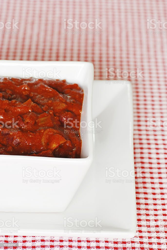 Texas style chili in a square bowl close up stock photo