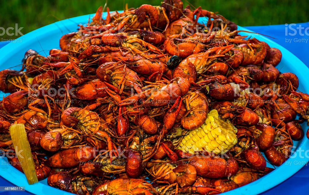 Texas Style Crawfish Bowl with Cajun Spicy Pile of Food stock photo