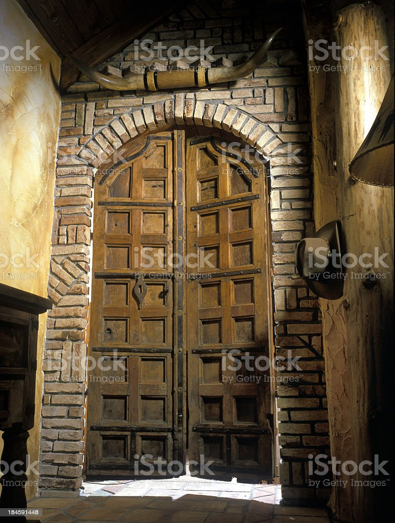 Texas style portal with swinging wooden doors stock photo