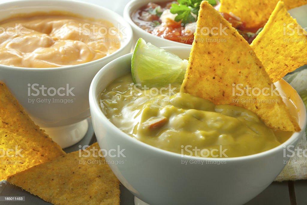 TexMex Food: Guacamole, Cheese Dip, Salsa and Nachos stock photo