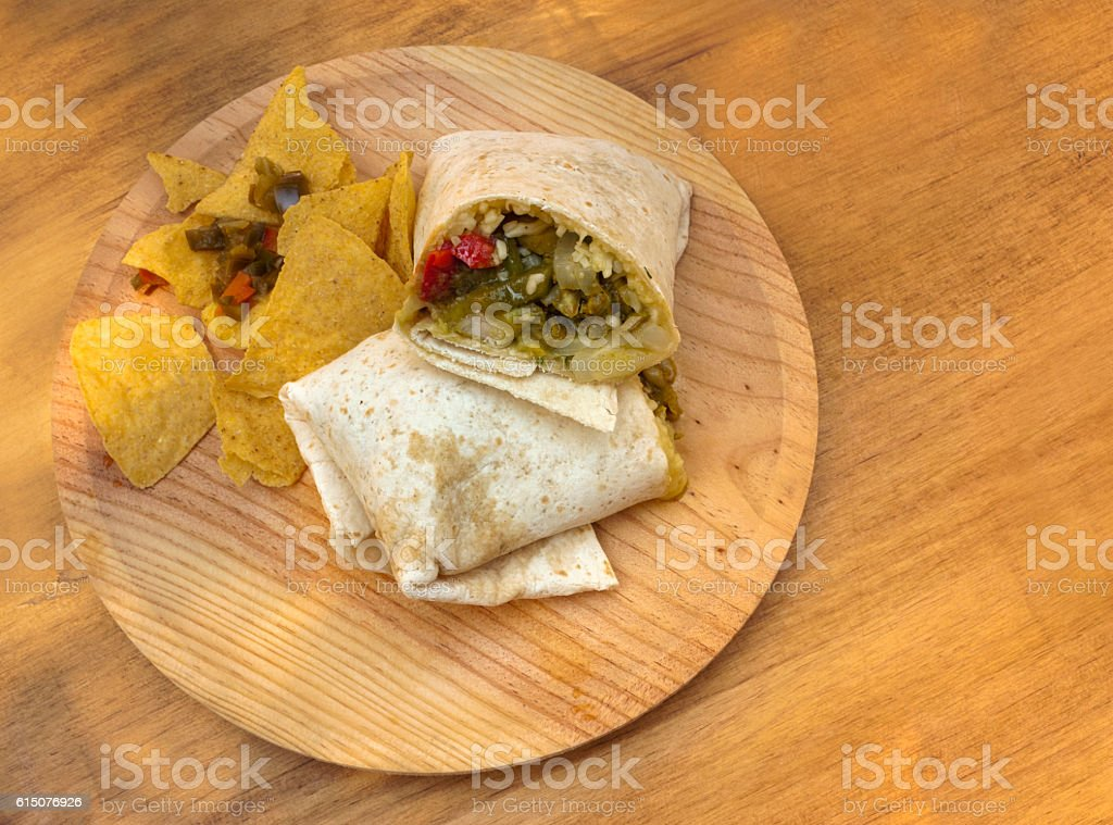 Tex-mex food, quesadilla, nachos, and peppers stock photo