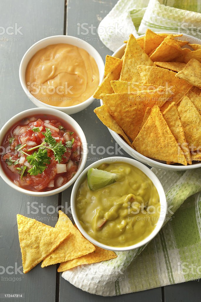 TexMex Food: Salsa, Guacamole, Cheese Dip and Nachos royalty-free stock photo