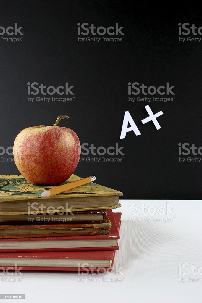 Text books with apple and pencil royalty-free stock photo