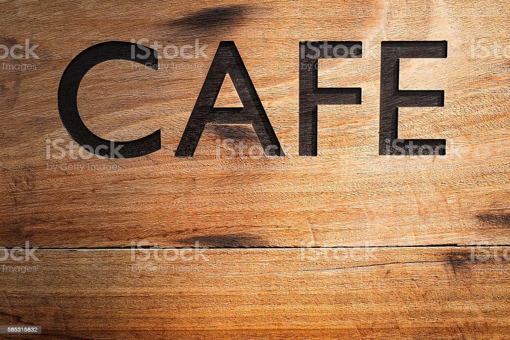 CAFE text carved on wood. stock photo