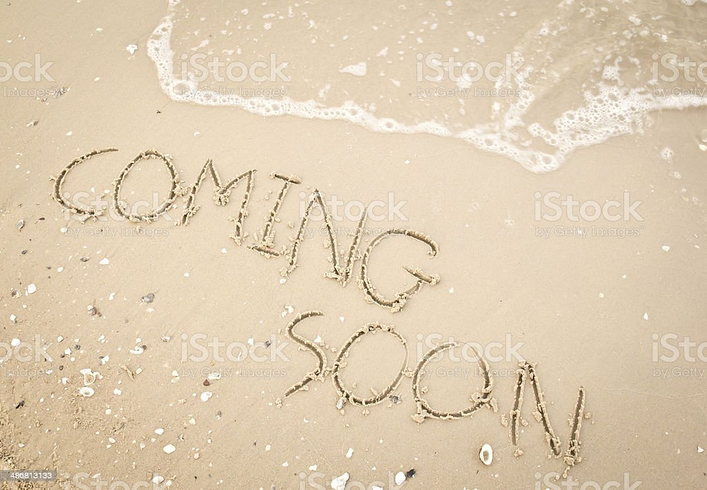Text coming soon on the sandy beach stock photo