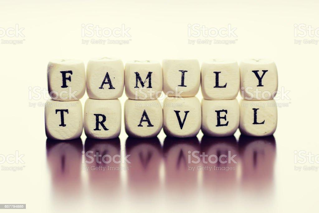 text cube travel family stock photo