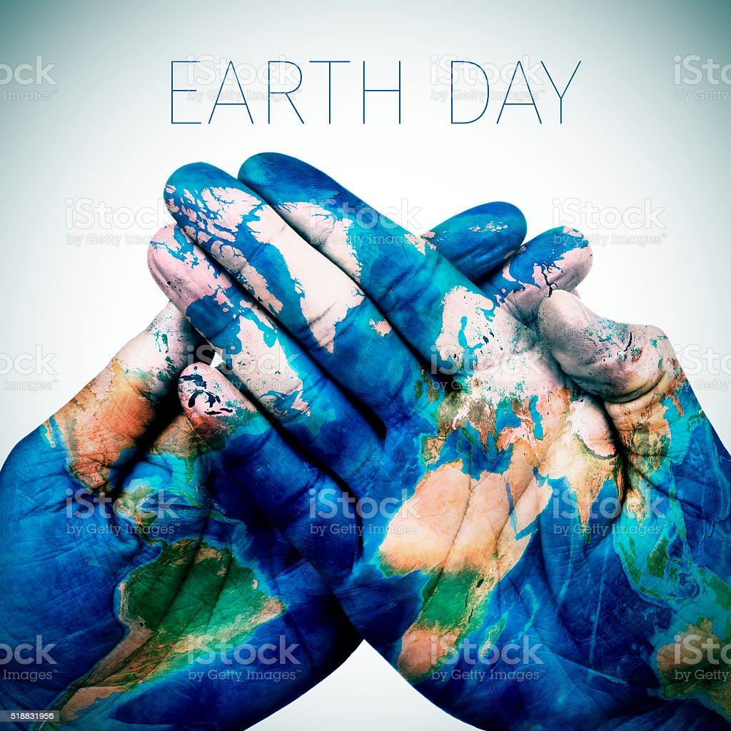 text earth day and world map (furnished by NASA) stock photo