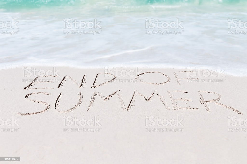 text end of summer on beach stock photo