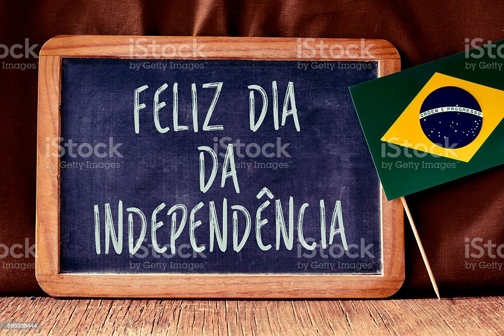 text Feliz Dia da Independencia and Brazilian flag stock photo
