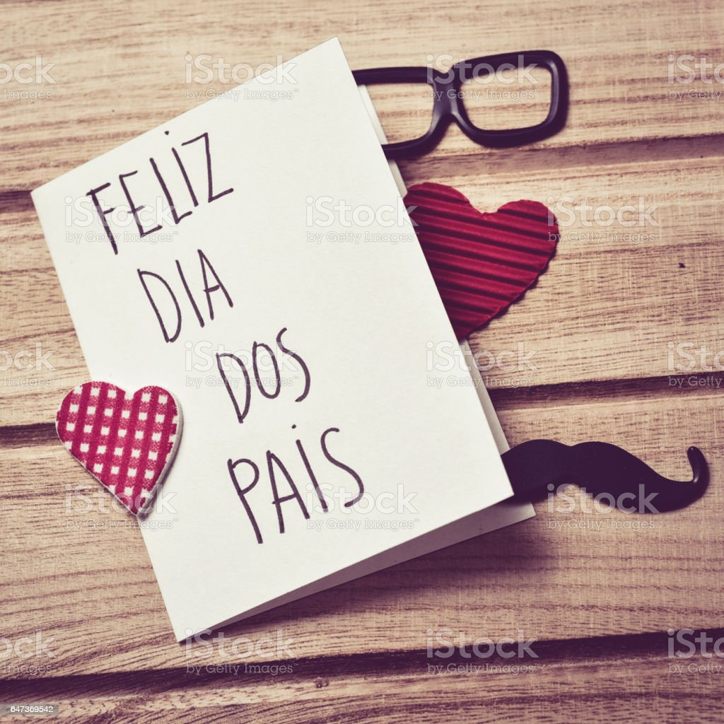 text feliz dia dos pais, happy fathers day in Portuguese stock photo
