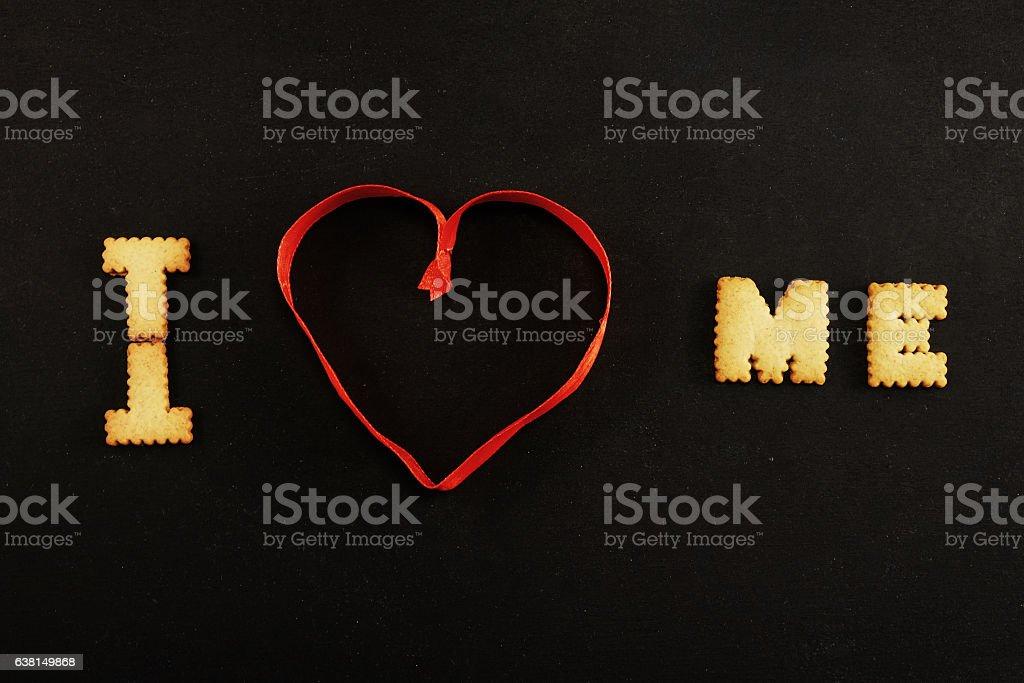 Text I heart me on black stock photo