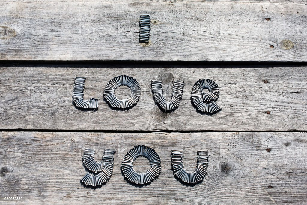 Text I LOVE YOU written by metal nails stock photo