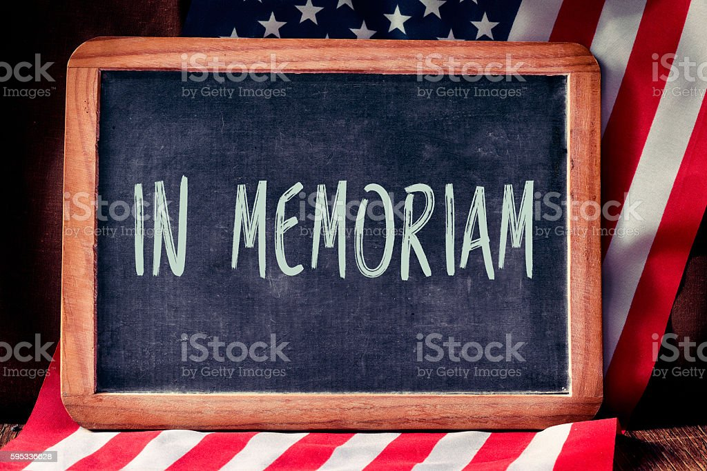 text in memoriam and flag of the United States stock photo