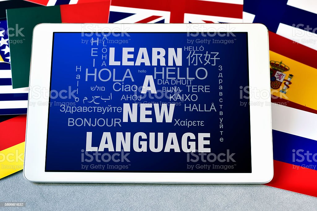 text learn a new language in a tablet computer stock photo