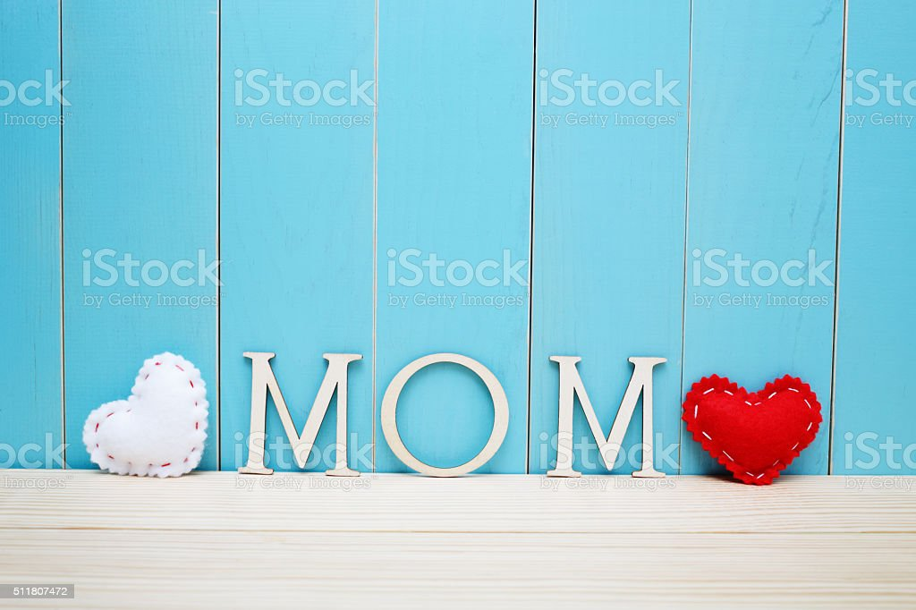 MOM text letters with white and red hearts stock photo