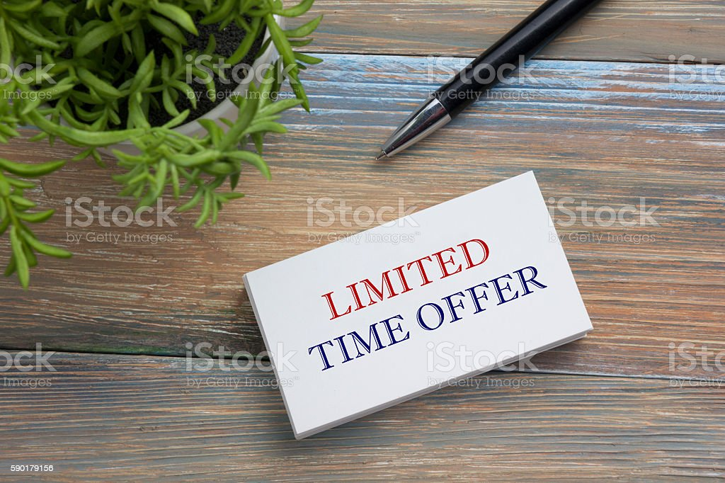 Text Limited time offer on white paper book and office stock photo