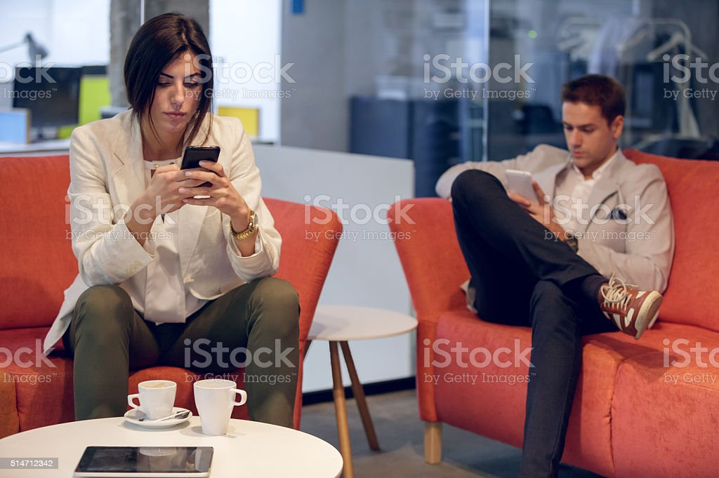 Text messaging on a break stock photo