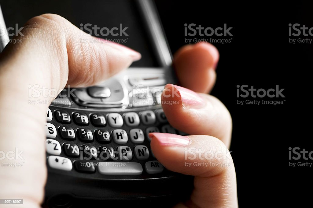 Text messaging on a wireless PDA smart phone royalty-free stock photo