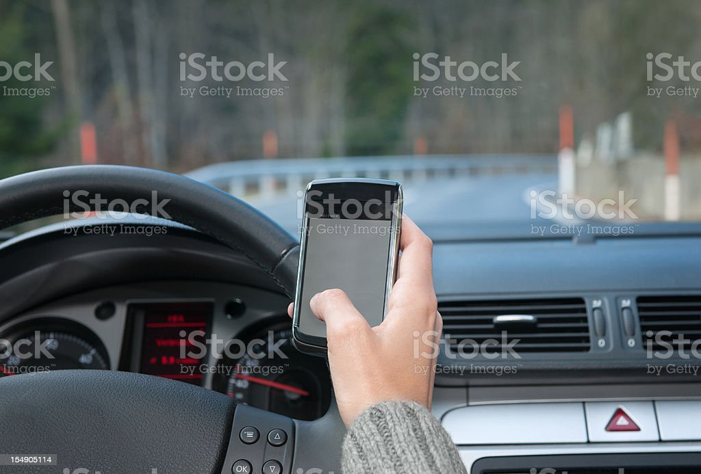 Text Messaging while Driving (XXXL) royalty-free stock photo