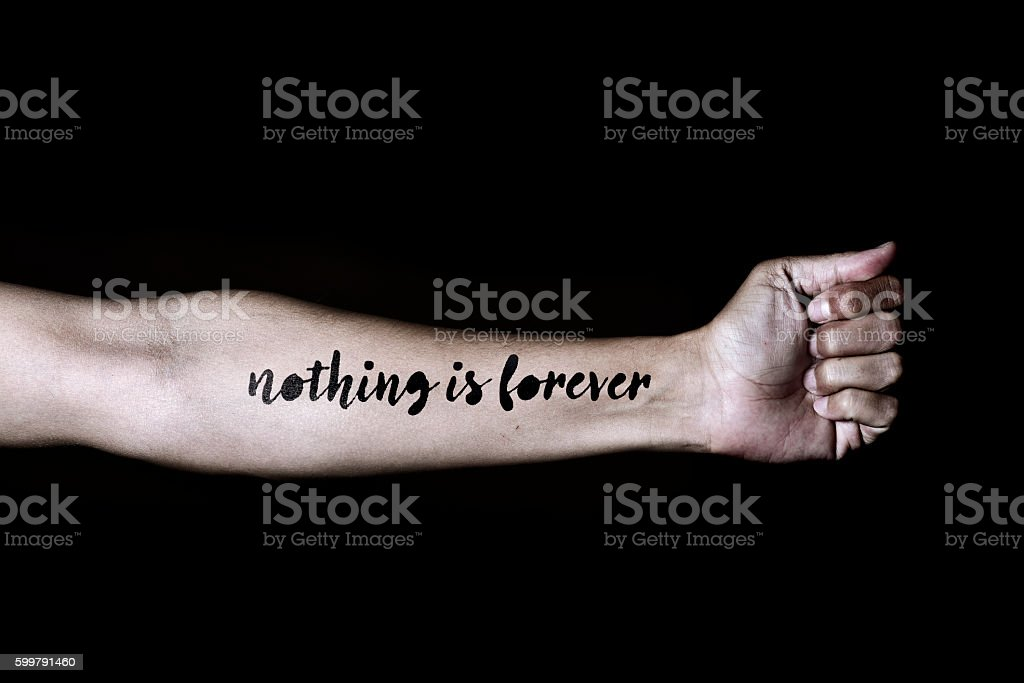 text nothing is forever in a forearm stock photo
