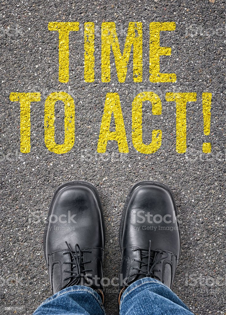 Text on the floor - Time to act stock photo