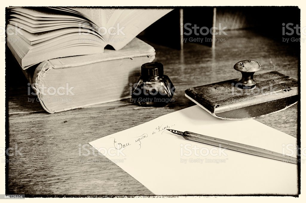 """Text """"Once upon a time"""" and stationary. Grain noise added. stock photo"""