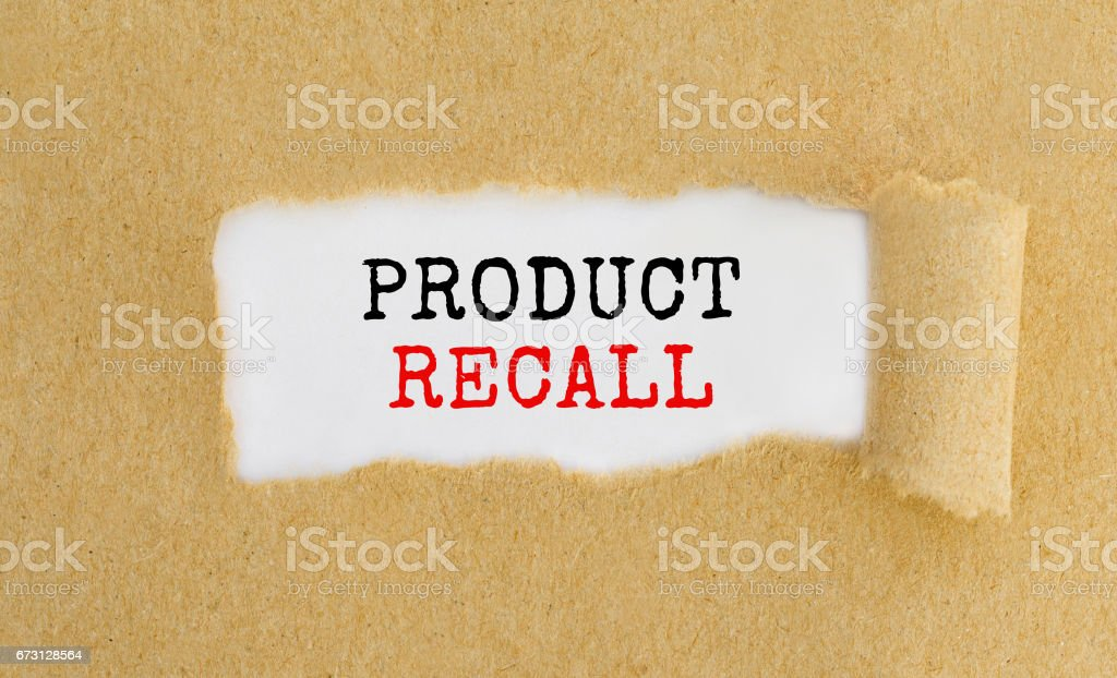 Text Product Recall appearing behind ripped brown paper. stock photo