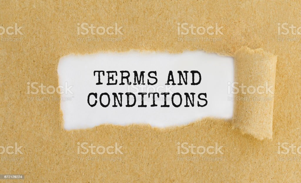 Text Terms And Conditions appearing behind ripped brown paper. stock photo