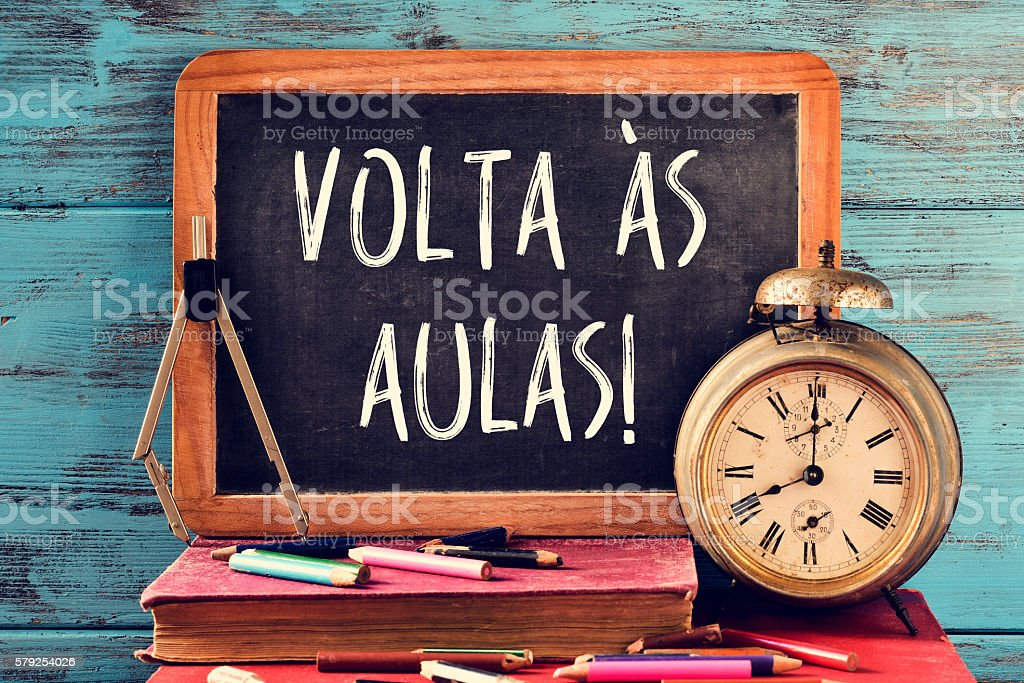 text volta as aulas, back to school in portuguese stock photo