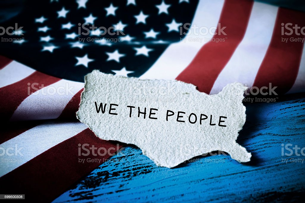 text we the people and flag of USA stock photo