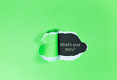 Text 'What's your story?' appears under the torn paper.