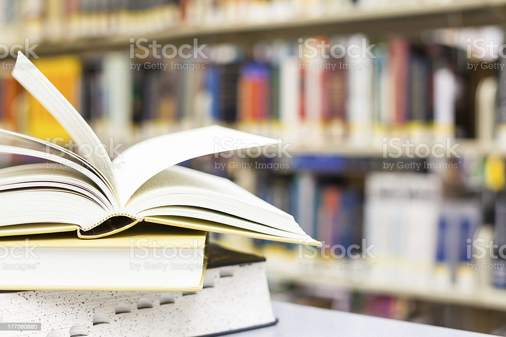 textbook open in school setting stock photo