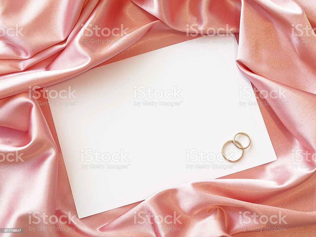 Textile border with golden wedding rings royalty-free stock photo