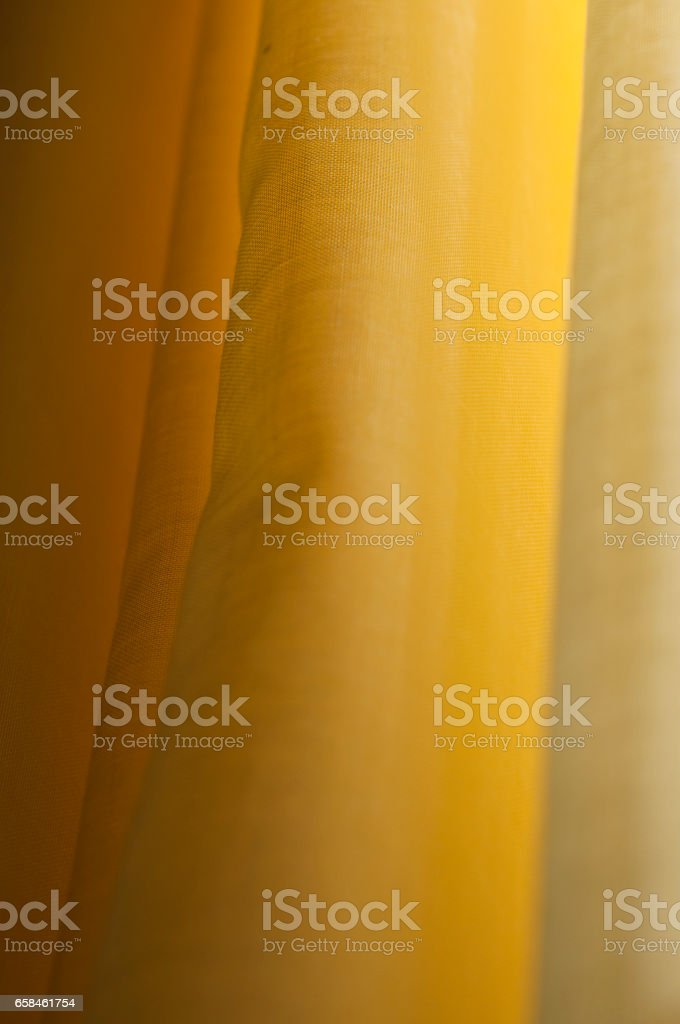 textile curtain in folds, back lit stock photo
